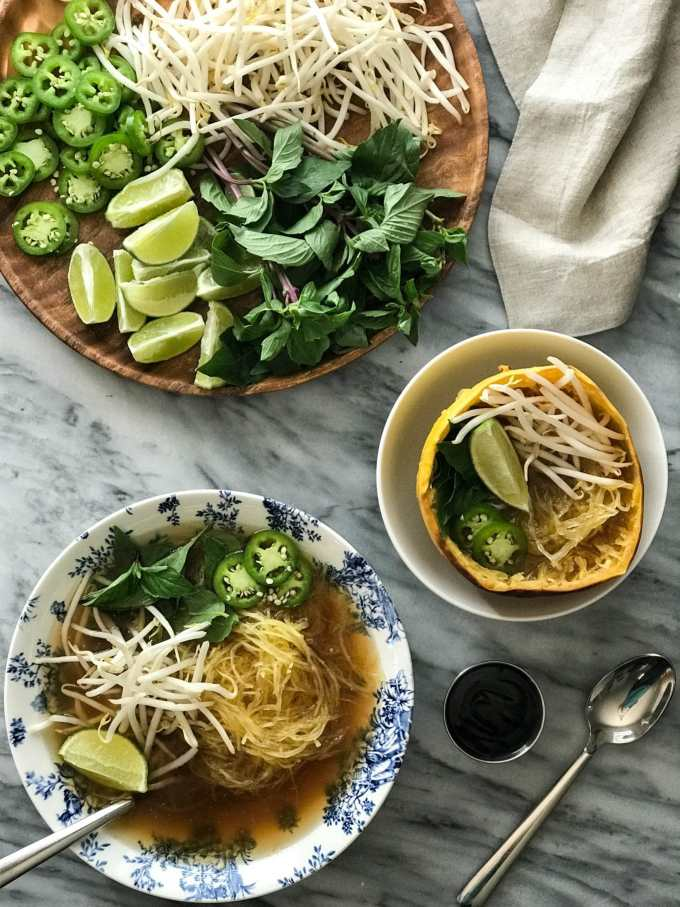 Spaghetti Squash Vegan Pho | Pho in bowls with toppings of mung bean sprouts, lime, jalapeño, thai basil | https://passtheplants.com/