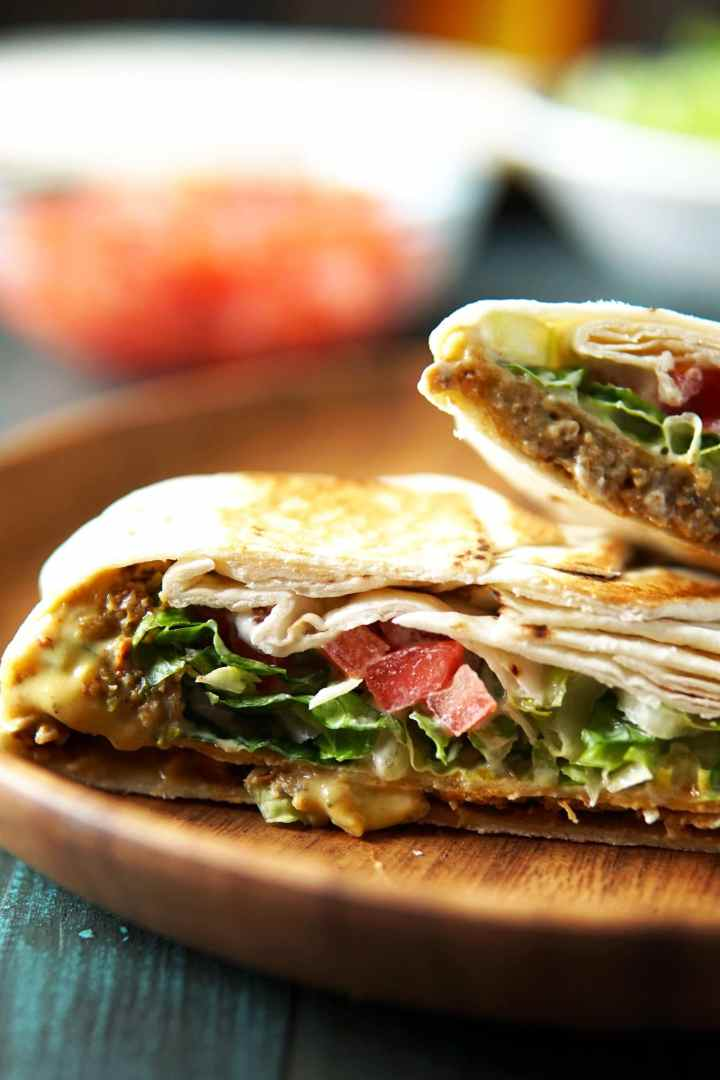 close-up of vegan crunchwrap supreme with the vegan taco meat as a layer