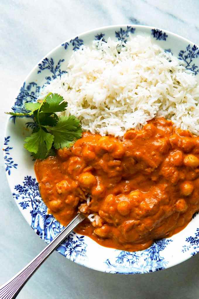 Vegan tikka masala simmer sauce with chickpeas and basmati rice in a bowl