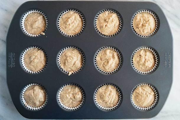 muffin batter in muffin tins