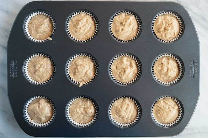 muffin batter in muffin tins