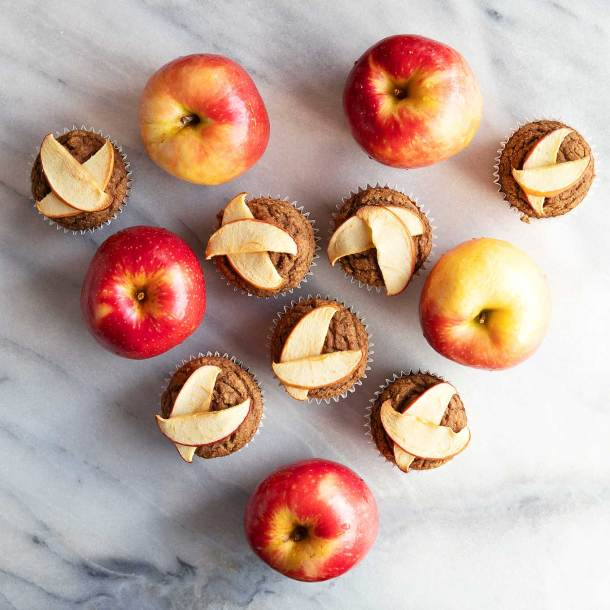 apple cinnamon almond blender muffins arranged with apples in a heart shape