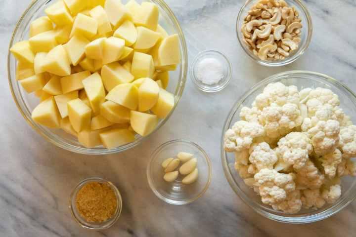 Ingredients for vegan mashed potatoes - potatoes, cauliflower, garlic, nutritional yeast, raw cashews, salt