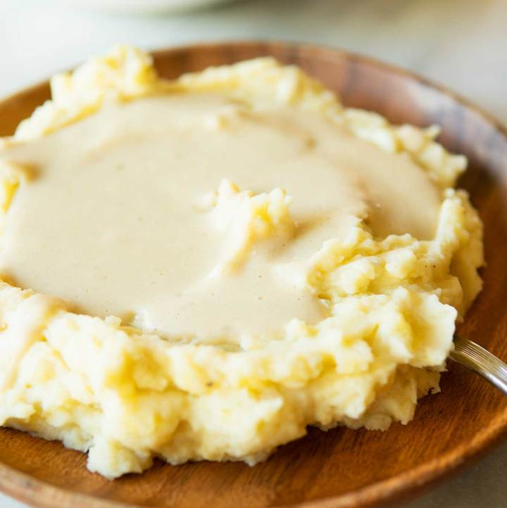 protein-packed vegan white gravy poured over vegan mashed potatoes