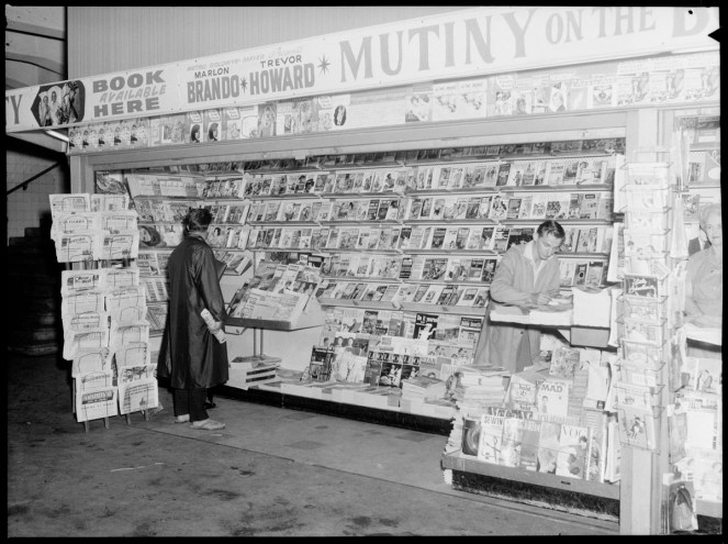 Photos of newspapers, newspaper stand in Sydney, Australia, and men reading the news of the lunar landing
