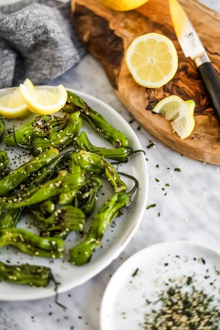 shishito peppers with lemon wedges garlic furikake