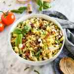 Italian Summer Pasta Salad with wine and ingredients
