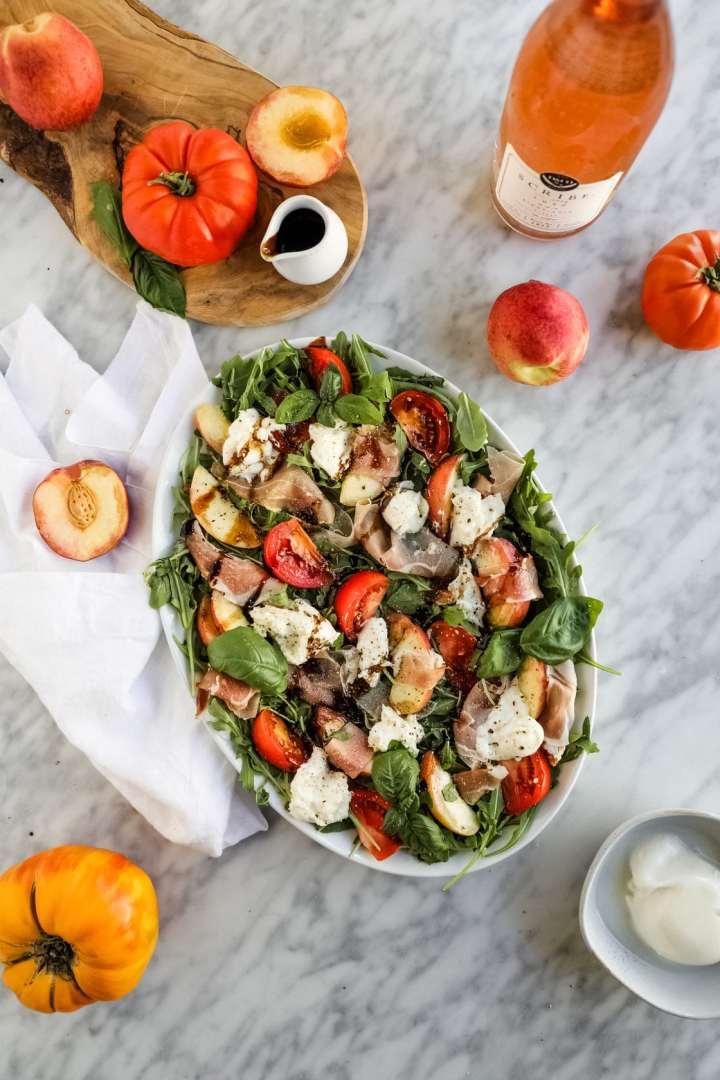 prosciutto burrata arugula tomato peach salad with balsamic glaze