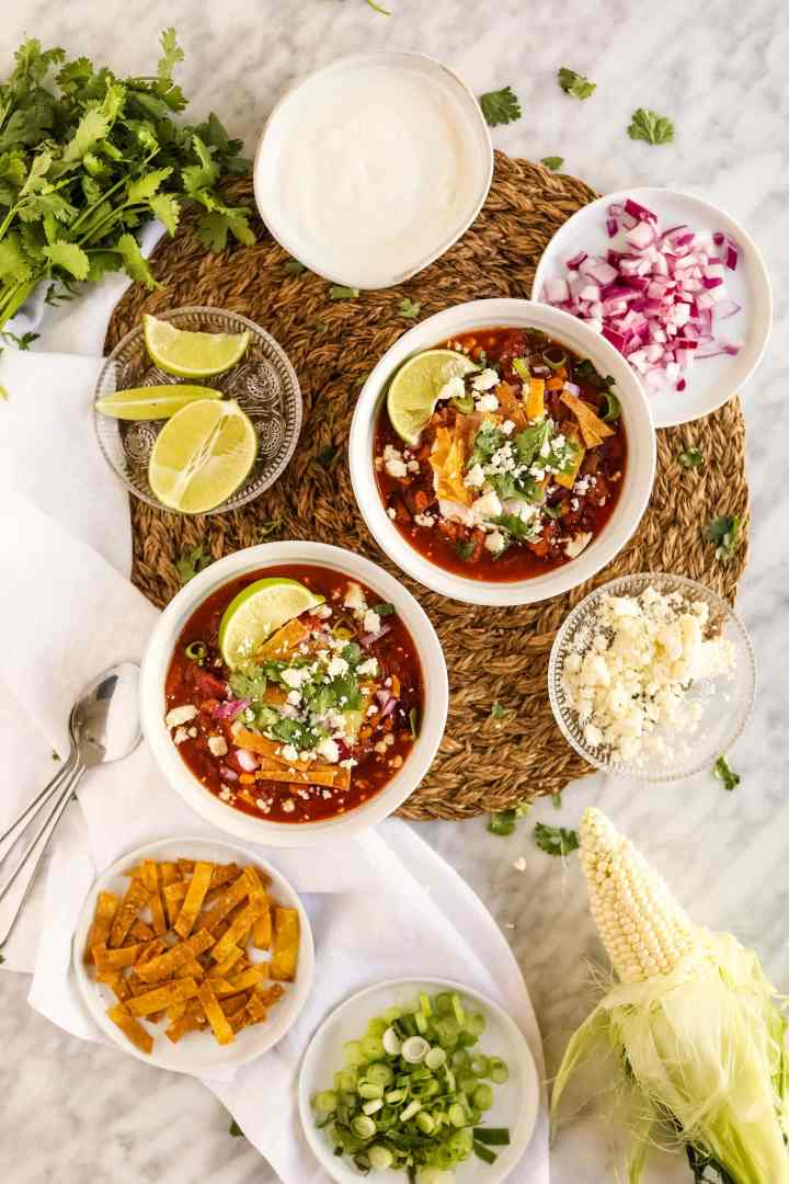 Healthy Turkey Chili in bowls with toppings