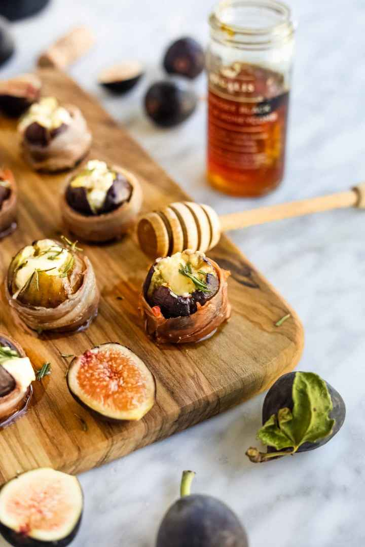 Prosciutto-Wrapped Figs with Goat Cheese with drizzled honey