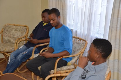 Students relax after lunch at the Guest House.