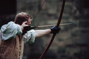 Archer with an arrow drawn ready to shoot in his bow.