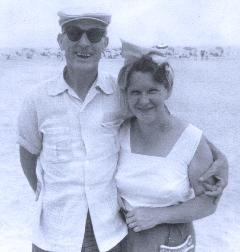 Are these my grandparents or someone else's who showed up in my packet of photos?  (They're mine, and is perhaps the only photo of one of my grandparents with SHADES!)