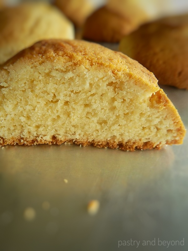 Cake-like vanilla cookie cut in half showing the inside.