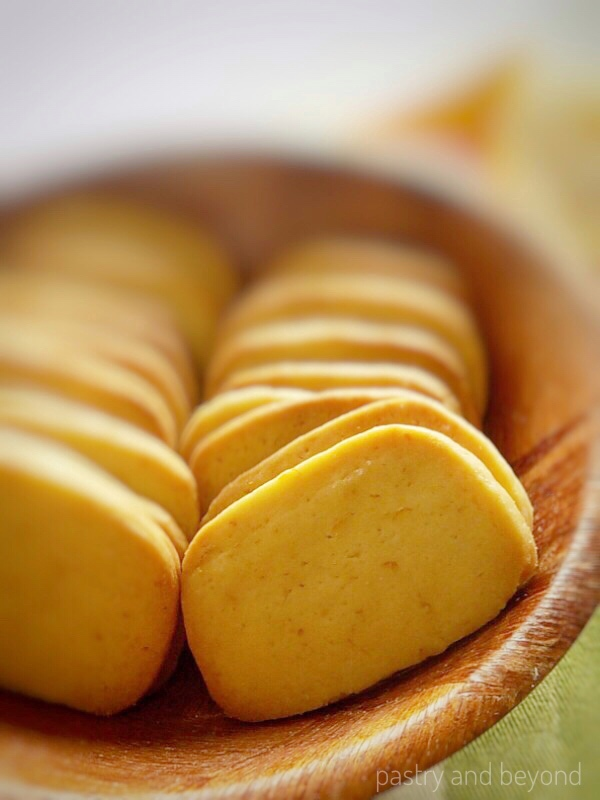 Lemon Slice-and-Bake Cookies on a wooden bowl in a row.