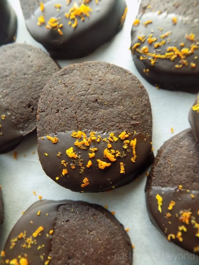 Slice and Bake Chocolate Orange Shortbread Cookies on a white surface.