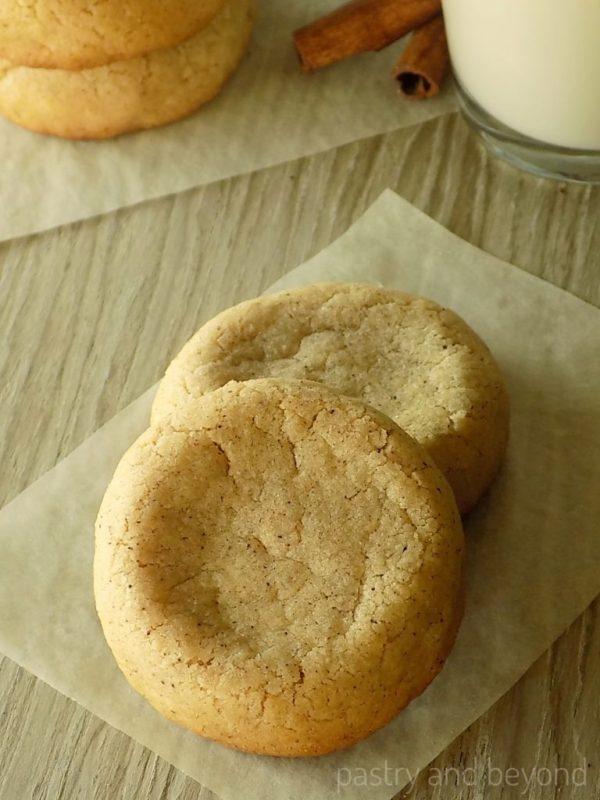Soft cinnamon cookies on a parchment paper.
