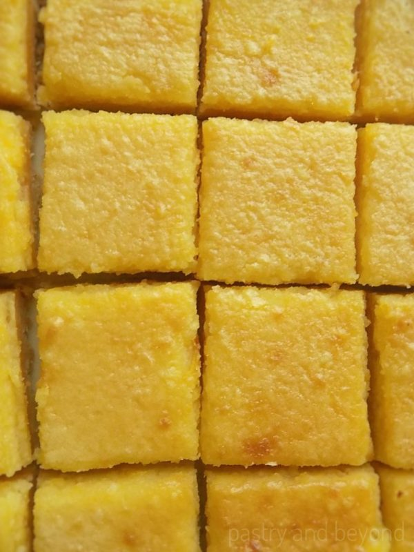 Lemon curd bars next to each other.