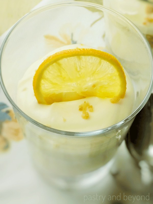 Lemon Curd Mousse with Candied Lemon Slice in a Serving Glass