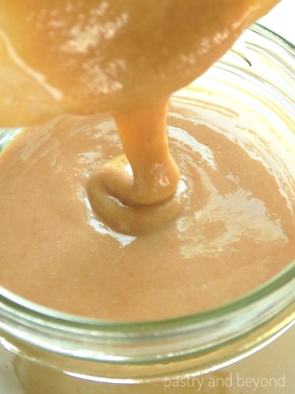 Pouring the Homemade Tahini into a jar.