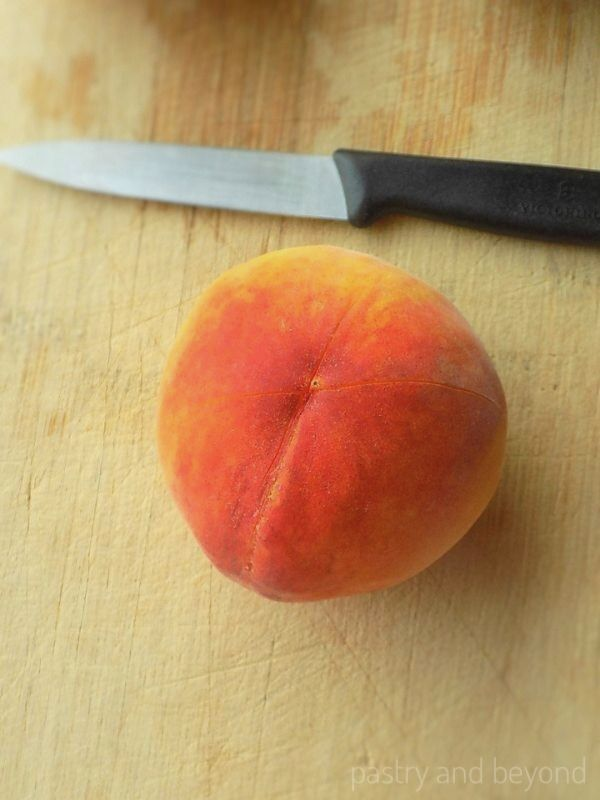 """How to Peel Peaches: Making a """"X""""sign on the bottom of a peach"""