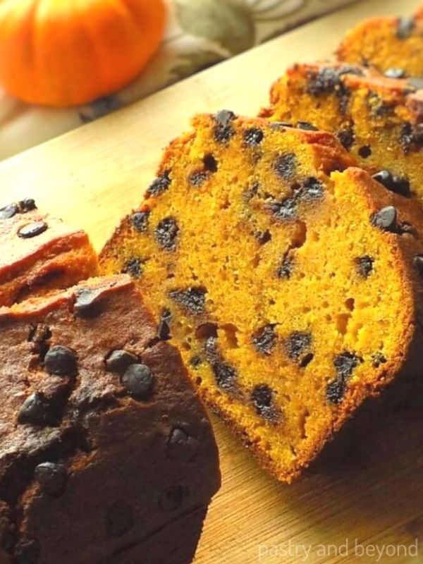 Pumpkin Chocolate Chip Bread on a wooden chopping board.