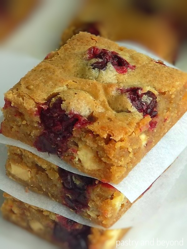 Side view of cranberry blondies.