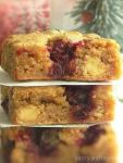Stacked white chocolate cranberry blondies.