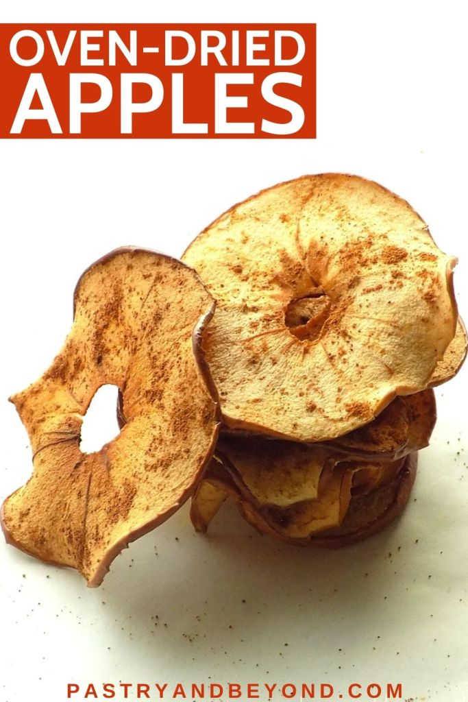 Stacked dried apples with text overlay.
