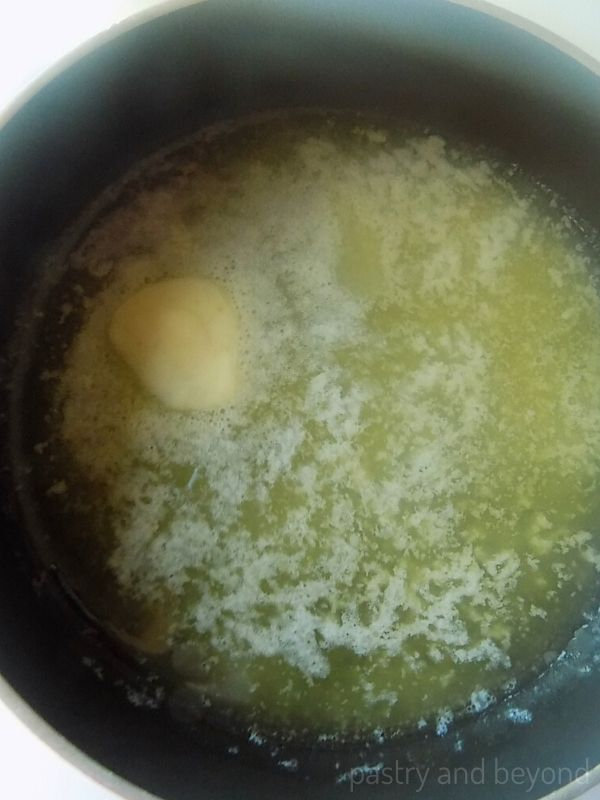 Halfway melted butter in a pan.
