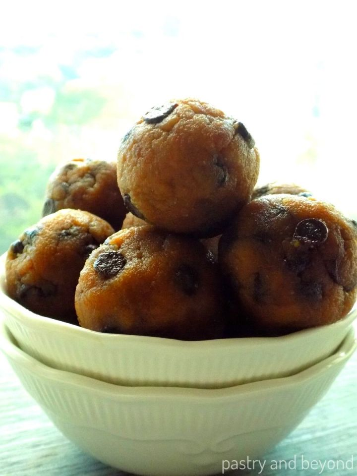 Peanut butter oat balls with chocolate chips in a white bowl.