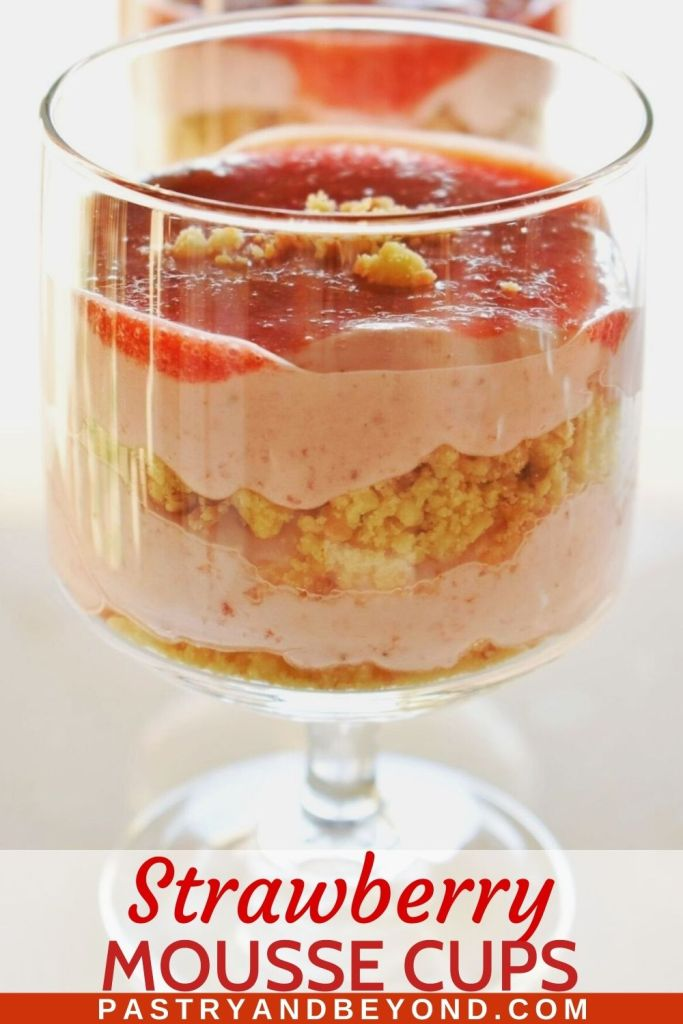 Strawberry mousse, crushed cookies and a strawberry puree as layers in a serving glass.