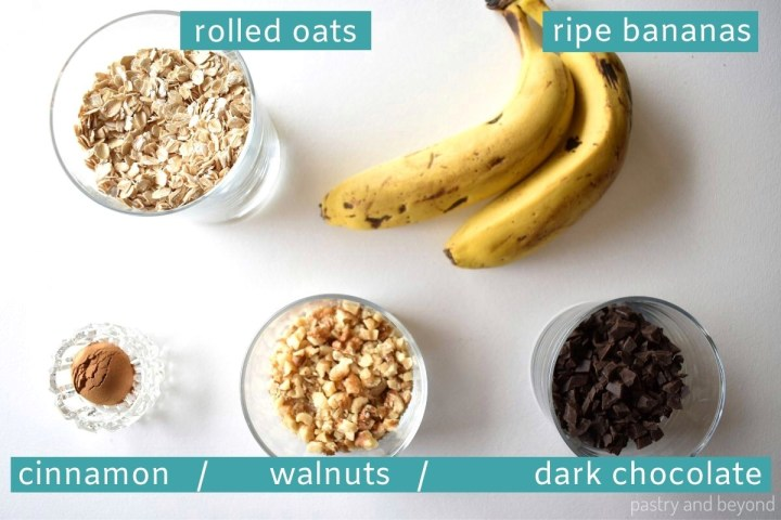Ingredients of banana cookies on a white surface.