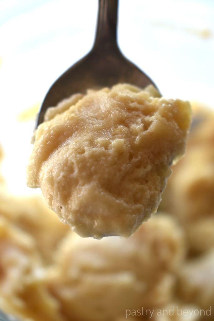 Peanut butter banana ice cream on a spoon.