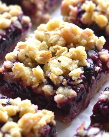 Blueberry oatmeal crumble bars on a parchment paper.