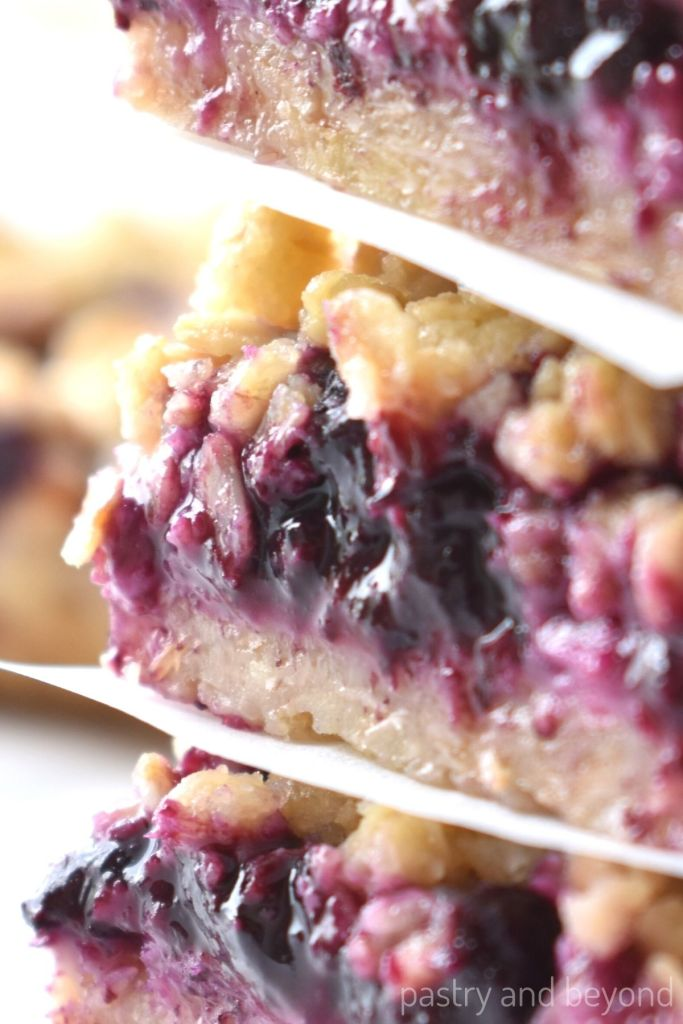 Close up of stacked blueberry bars.