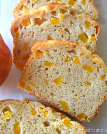 Slices of peach bread on a white surface.