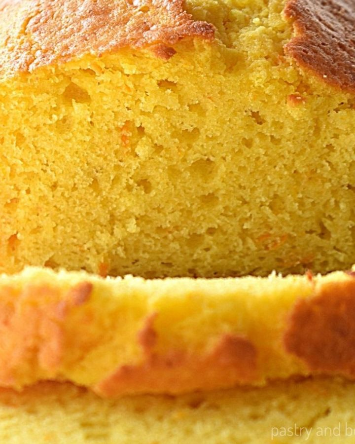 Orange cake loaf with slices.
