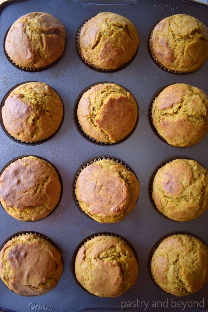 Pumpkin banana muffins in a muffin tin.
