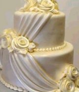 Pearl wedding cake with drapes