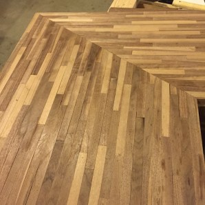 Scraping the Excess Glue on our faux butcher block counter