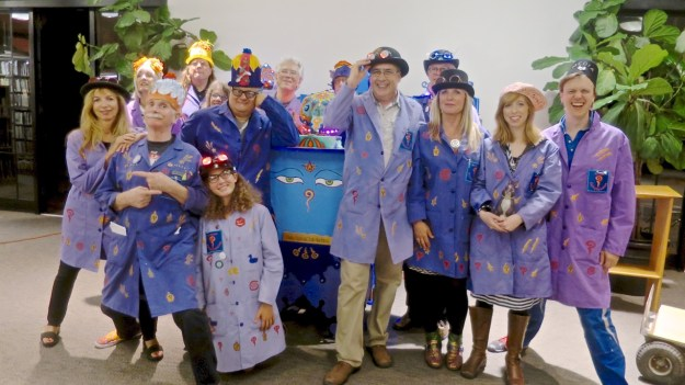 The 'Pataphysical Studio team unveils the Slot Machine at the Mill Valley Library. Front Row (L-R): Janey Fritsche, Howard Rheingold, Natalie Frederick, Fabrice Florin, Stephanie Levene, Ilyse Magy, Justin Hall. Back Row (L-R): Jean Bolte, Tim Pozar, Priscilla Wheeler, Mark Petrakis, Donald Day, Marshall Smith, Freddy Hahne.