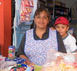 María Elena Neri Flores and her son at her tienda in Tecámac across from a school. She sells her sewn goods including school uniforms and snacks.