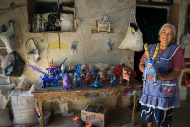 Jesús Jimenez Hernandez in her open-air alebrije workshop in her home in Arrazola, where many women paint these fanciful figures.