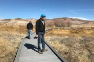 Len Warren, right, and John Zablocki from the The Nature Conservancy stand on the boardwalk at the Torrance Ranch Preserve north of Beatty on Feb. 8, 2019. Henry Brean Las Vegas Review-Journal