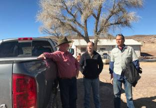 Rancher Hank Brackenbury, left, chats with John Zablocki, center, and Len Warren from The Nature Conservancy at the 7J Ranch on Feb. 8, 2019. Henry Brean Las Vegas Review-Journal