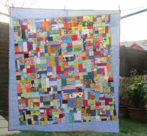 Blue scrap quilt by Allison Reid