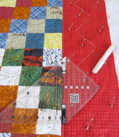 Scrappy Trip Along marking the border quilting by Allison Reid