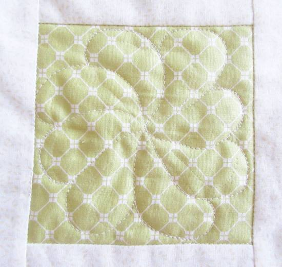 Square in a Square FMQ feather swirl by Allison Reid