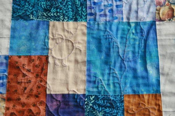 Colcha de patchwork diseño joven marino